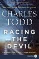 Racing the devil [text(large print)]/ an Inspector Ian Rutledge mystery