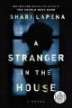 A stranger in the house [large print] : [a novel]
