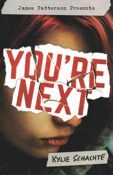 face of girl with brunette hair with you're next written across