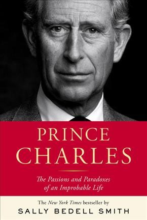 Black and white photo of Prince Charles above red background featuring the title of the book