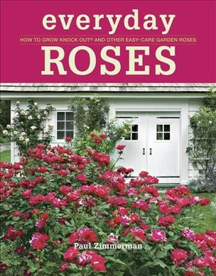 red roses growing in front of white building with title in white lettering on red background border above photo