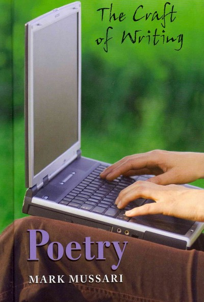 image of child's hands typing on the keyboard of a laptop computer with unfocused image of forest in the background